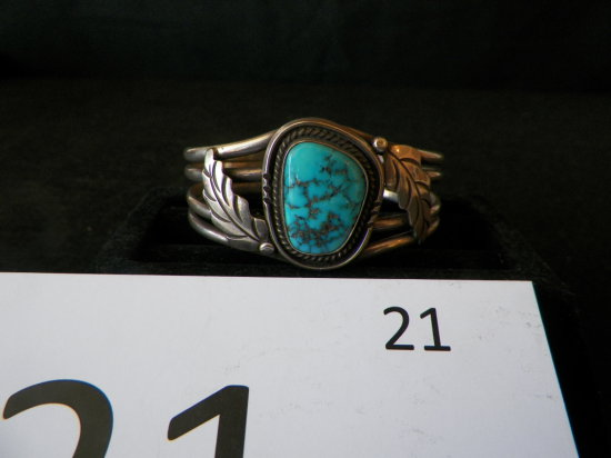 Silver Navajo Bracelet with One Morenci Turquoise Stone. Set with Rope Desi