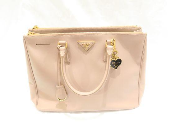 "Prada Saffiano handbag, medium size bag, 13.5"" x 9"" x 6"", three utility pockets, small zip pocket"