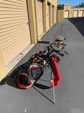Golf Clubs: Taylormade Red and Black Golf Bag with Warrior 9.5 Driver, Warrior 3, 5 Wood, Bazooka 3