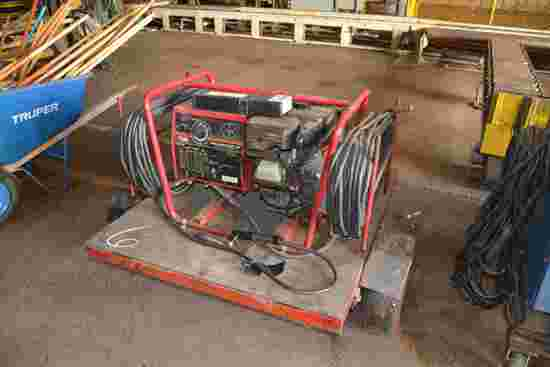 LINCOLN MODEL 125 WELDER W/ BRIGGS GAS ENGINE MOUINTED ON SINGLE AXLE TRAILER           1,254 HOURS