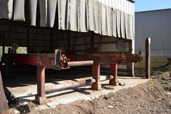 MELLOTT 24' 3 STRAND LOG DECK W/ 3 ARM STOP & LOADER W/ NOSE SKIDS W/ HYDRAULIC DRIVE