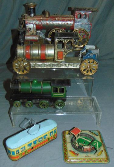5 Tin Train Toys