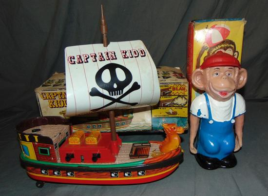 (2) Boxed Battery Op Toys, Pirate Ship & Monkey
