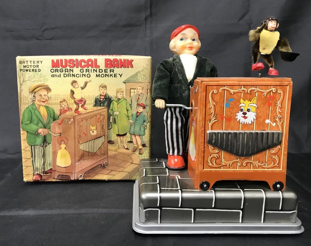 Tin Musical Organ Grinder & Monkey Bank.