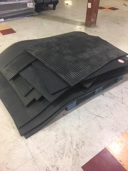 Contents of pallet various heavy floor mats