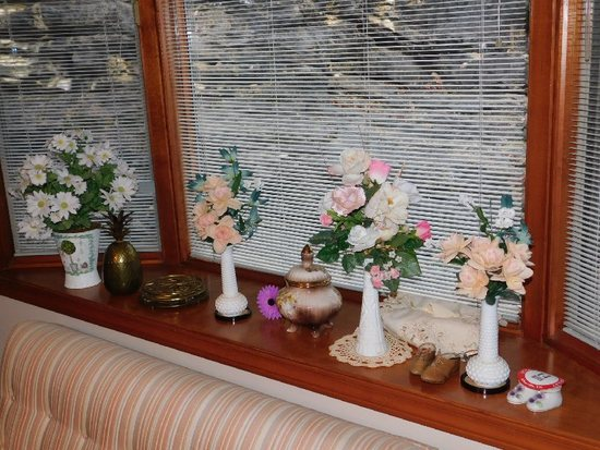 Various Faux Plants, Small Vases In Window Seal