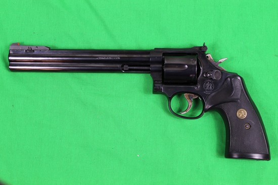 Smith & Wesson Model 586, caliber 357 magnum, s/n AUD7206.  Blue finish, 8