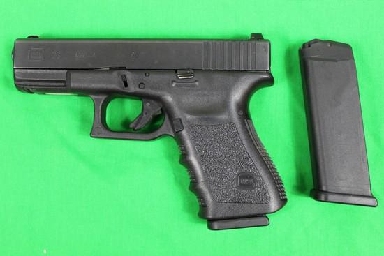 Glock 23, caliber 40 S&W, s/n EGE091 Made in Austria.  Early model, 2 mags,