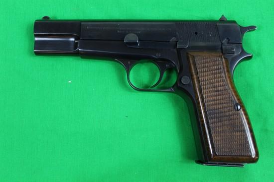 Browning Hi-Power, caliber 9mm, s/n 72C48259.  Blue finish, 1 mag, factory