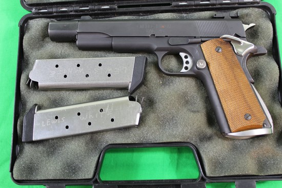 Springfield Armory 1911A1, caliber 45 auto, s/n NM68053.  Multiple upgrades