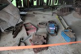 Contents of Concrete Pad:Ford Front Weights, Culipacker Parts, Tractor Bump
