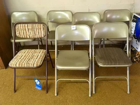 Seven Folding Chairs