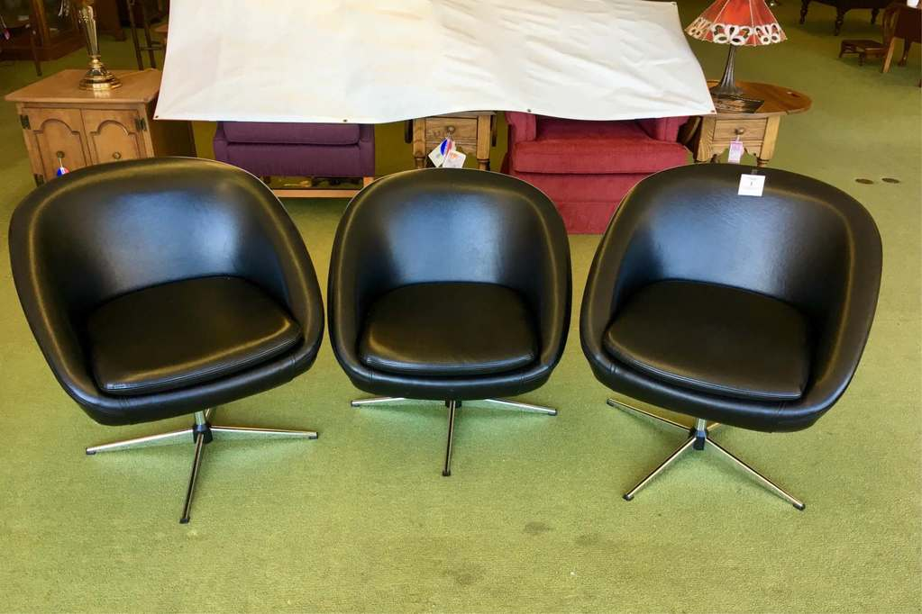 Three Faux Leather Swivel Chairs