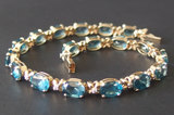 14KT GOLD & BLUE TOPAZ DIAMOND TENNIS BRACELET