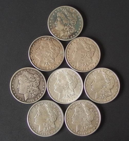 8 MORGAN SILVER DOLLAR COINS