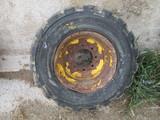 12-16.5 tire & rim