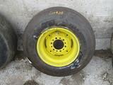 New 11L-15FI tire & rim