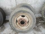 Two 215/85R16 tires & rim
