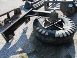 Skid loader rubber tire feed pusher