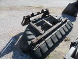Skid loader rubber tire scrapper