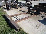Skid loader pallet forks made into scraper