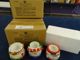 4 Boxes of Christmas Candle Holders
