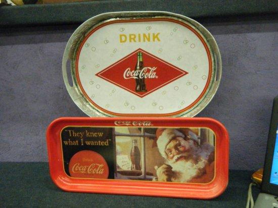 Two Coca-Cola trays