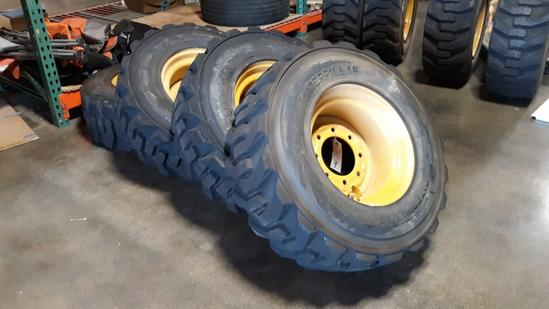 (4) CATERPILLAR Pneumatic Skid Steer Rims and Tires***LIKE NEW***