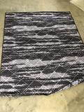 Reversible purple rug