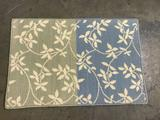 Blue/green welcome mat