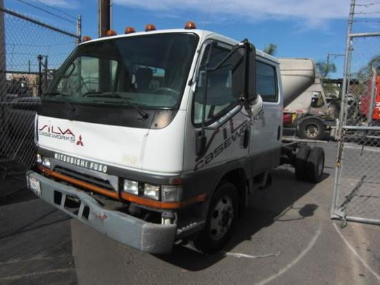 2002 Mitsubishi Fuso FE640W Crew Cab with 12ft Bed Length Capacity and 14,500 G.V.W.R.