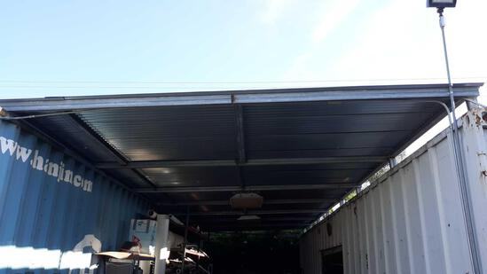 Approx. 40ft L x 14ft W Corrugated Overhang with Interior Lighting