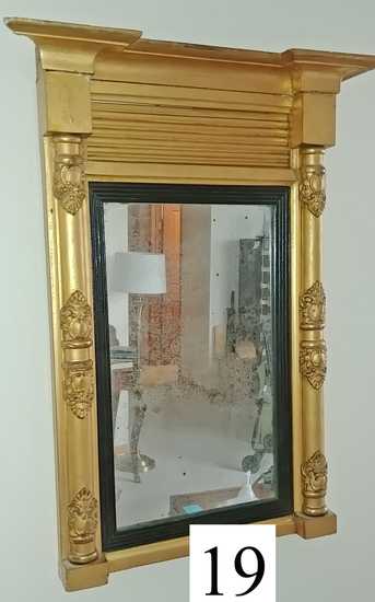 small mirror in gilt frame