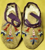Early pair of beaded leather moccasins