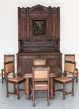 Heavily carved black forest 8 pc dining room suite