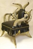 Large brown leather upholstered horn chair