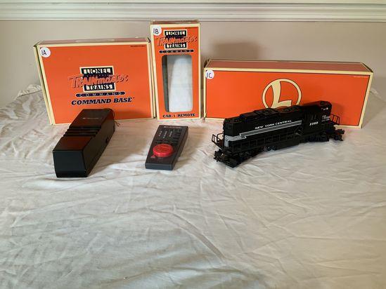 1A- Lionel TrainMaster Command Base #6-12911; 1B- Lionel TrainMaster CAB-1 Remote #6-12868; 1C- Lion