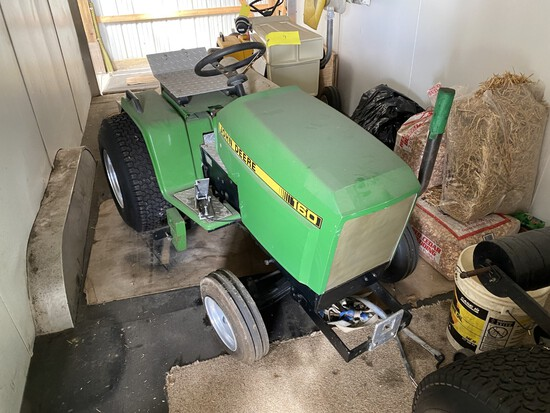 John Deere 160 w/skid plates & wts. This was a successful puller in the 1000-1100# class.