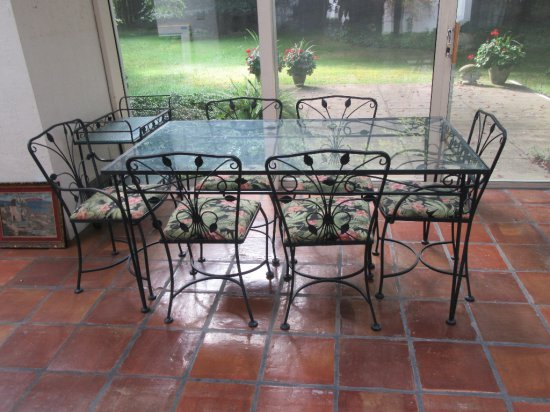 GLASS TOP WROUGHT IRON PATIO TABLE AND 6 CHAIRS THAT INCLUDE 2 HOST CHAIRS