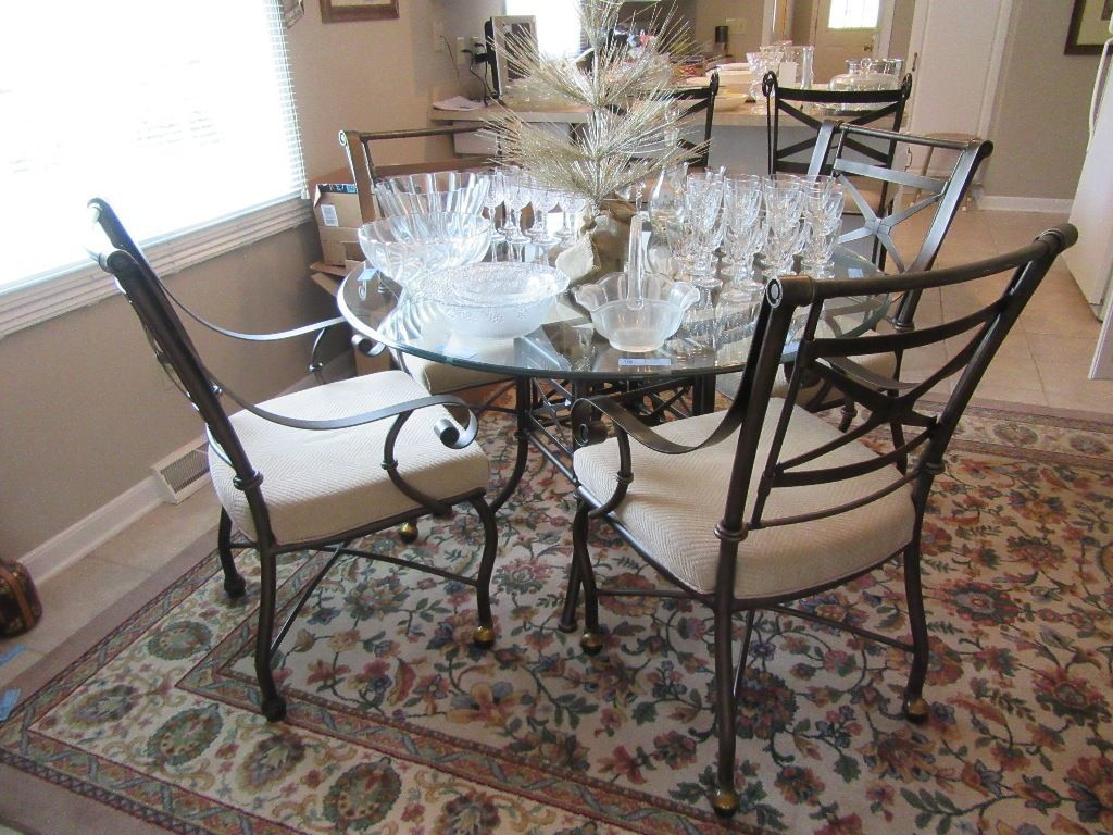 ROUND GLASS TOP TABLE WITH 4 MATCHING CHAIRS. ONE COASTER MISSING