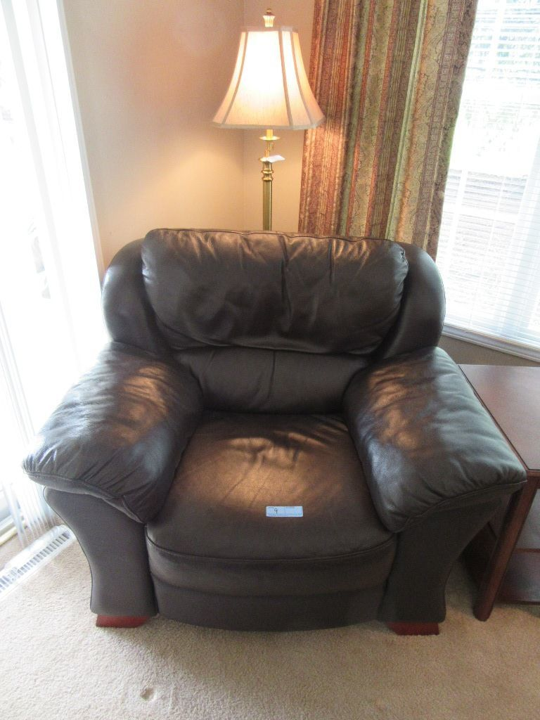 BROWN FAUX LEATHER OVERSIZED CHAIR