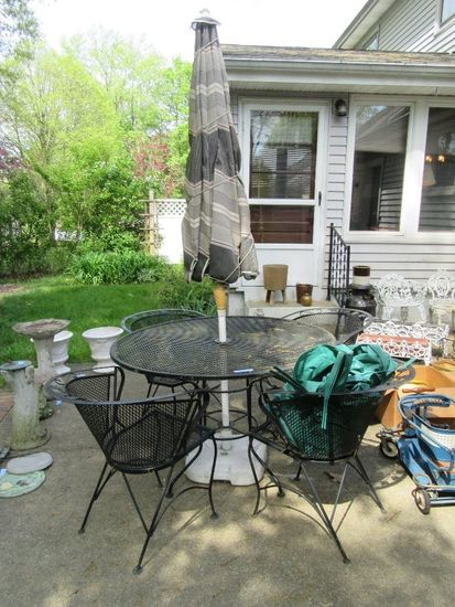 WROUGHT IRON UMBRELLA TABLE AND 4 CHAIRS