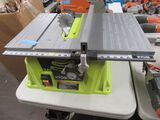 RYOBI 10-INCH TABLE SAW WITH LEGS. MODEL NUMBER RTS10G