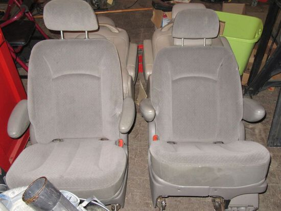 GRAY VAN SEATS. NOT SURE WHAT THEY FIT