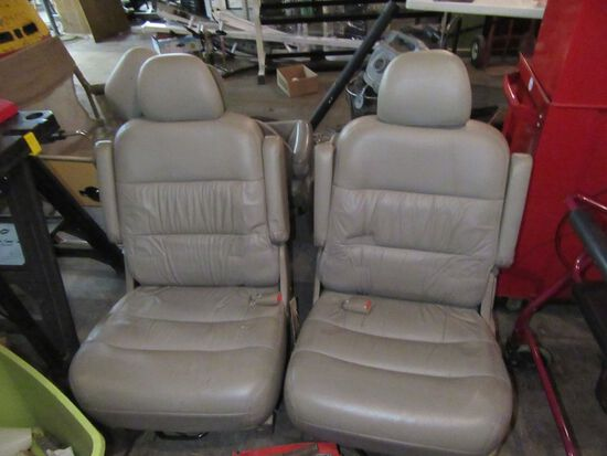 TAN LEATHER VAN SEATS. NOT SURE WHAT THEY FIT