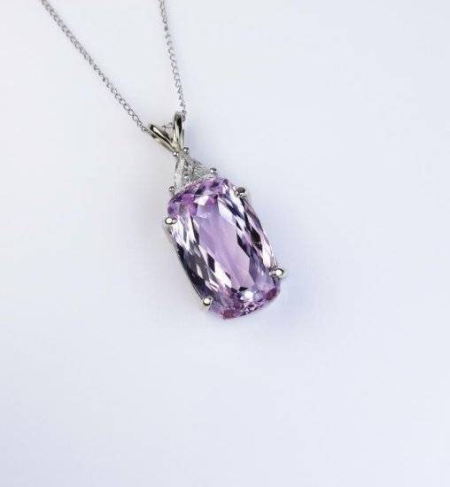 Amazing Pendant featuring a Fine intense pink Kunzite weighing approx. 15.00