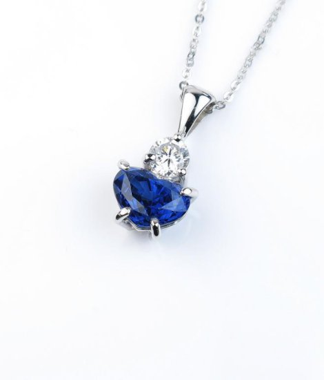 Very high quality ladies pendant featuring a natural no Heat Blue