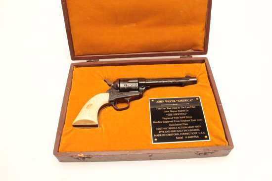 Colt SAA revolver engraved and silver inlaid with carved ivory grips inlaid