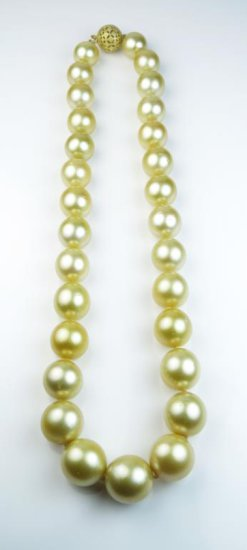 Very Important captivating strand of Golden Tahitian South Sea Pearls averaging 12.00