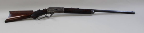 "1886 Winchester deluxe rifle with factory engraved name ""N.L. Milland"""